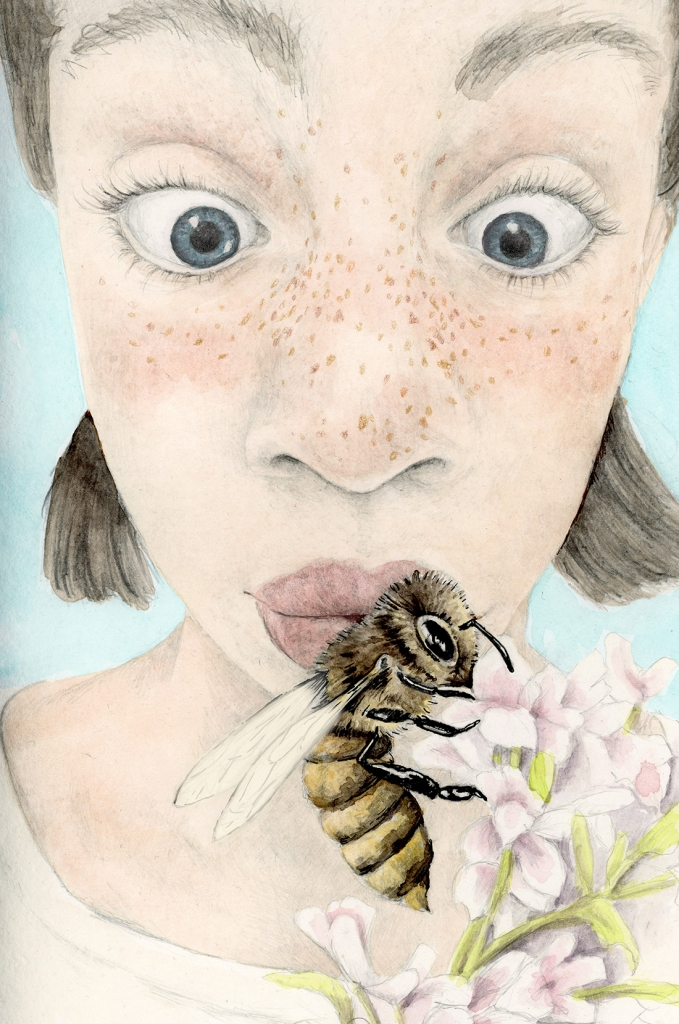 Close up of a freckled girl with wide blue eyes looking at an enlarged honey bee gathering pollen in light pink flowers.